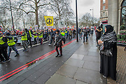 On Park lane watched by guests from expensive hotels - A march against racism and to ban the ban (against immigration from certain countries to the USA) is organised by Stand Up To Racism and supported by Stop the War and several unions. It stated with a rally at the US Embassy in grosvenor Square and ended up in Whitehall outside Downing Street. Thousands of people of all races and ages attended. London 04 Feb 2017.