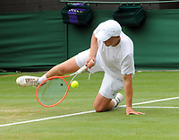 Lawn Tennis - 2021 All England Championships - Week Two - Wednesday - Wimbledon<br /> Boys event - Pedro Boscardin v Billy Blaydes<br /> <br /> Billy Blaydes of GBR slips on the grass<br /> <br /> Credit : COLORSPORT/Andrew Cowie