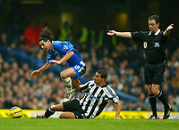 Fotball<br /> Premier League England 2004/2005<br /> Foto: BPI/Digitalsport<br /> NORWAY ONLY<br /> <br /> Chelsea v Newcastle United<br /> Barclays Premiership.<br /> 03/12/2004.<br /> <br /> Tiago of Chelsea is brought down by Jermain Jenas while referee, Rob Styles waves play-on