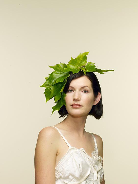 Portrait of woman 30-35, with decorative foliage head piece
