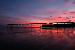 © Licensed to London News Pictures. <br /> 25/12/2016. <br /> Saltburn-by-the-Sea, UK.  <br /> <br /> The first light of dawn illuminates the sky over the beach and pier on Christmas morning in Saltburn by the Sea.<br /> <br /> <br /> Photo credit: Ian Forsyth/LNP