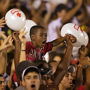 A young Vasco fan watches in amazement during the Fluminense FC V CR Vasco da Gama Futebol Brasileirao League match at the Maracana, Jornalista Mário Filho Stadium, Rio de Janeiro,  Brazil. 22nd August 2010. Photo Tim Clayton.