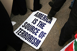An anti-American poster is seen in Beirut, Lebanon, March 8, 2005. Hundreds of thousands of pro-Syrian protesters gather and chant anti-American slogans. Hezbollah, the militant Shiite Muslim group, called for a nationwide demonstration against foreign intervention and to counter weeks of massive anti-Syrian rallies.
