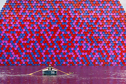 © Licensed to London News Pictures. 23/07/2018. London, UK. A woman rows past the London Mastaba, a floating sculpture by Christo, in the Serpentine in Hyde Park as hot weather continues in the capital. Forecasters are predicting record temperatures this week. Photo credit: Rob Pinney/LNP