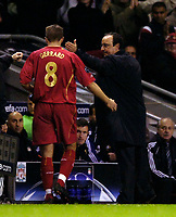 Photo: Jed Wee.<br />Liverpool v Anderlecht. UEFA Champions League.<br />01/11/2005.<br /><br />With the game won Liverpool manager Rafael Benitez (R) could afford to take captain Steven Gerrard off.