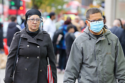 © Licensed to London News Pictures. 30/10/2020. London, UK. A woman wearing a face shield in north London. Pressure is mounting on the Prime Minister Boris Johnson and Ministers to impose a second national lockdown and London is likely to go into Tier 3 in the coming weeks as coronavirus cases are increasing. Photo credit: Dinendra Haria/LNP