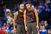 OKLAHOMA CITY, OK - APRIL 21: Damian Lillard #0 talks with CJ McCollum #3 of the Portland Trail Blazers during a game against the Oklahoma City Thunder during Round One Game Three of the 2019 NBA Playoffs on April 21, 2019 at Chesapeake Energy Arena in Oklahoma City, Oklahoma  NOTE TO USER: User expressly acknowledges and agrees that, by downloading and or using this photograph, User is consenting to the terms and conditions of the Getty Images License Agreement.  The Trail Blazers defeated the Thunder 111-98.  (Photo by Wesley Hitt/Getty Images) *** Local Caption *** Damian Lillard; CJ McCollum