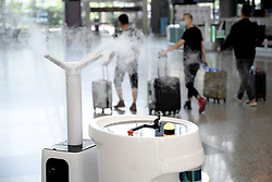 April 16, 2020, Guangzhou, Guangdong, China: The smart disinfection robot is working in the White Cloud Airport during the outbreak of the novel coronavirus in Guangzhou,Guangdong,China on 16th April, 2020. (Credit Image: © TPG via ZUMA Press)