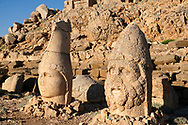 Statue heads, from right, Herekles & Apollo  in front of the stone pyramid 62 BC Royal Tomb of King Antiochus I Theos of Commagene, east Terrace, Mount Nemrut or Nemrud Dagi summit, near Adıyaman, Turkey .<br /> <br /> If you prefer to buy from our ALAMY PHOTO LIBRARY  Collection visit : https://www.alamy.com/portfolio/paul-williams-funkystock/nemrutdagiancientstatues-turkey.html<br /> <br /> Visit our CLASSICAL WORLD HISTORIC SITES PHOTO COLLECTIONS for more photos to download or buy as wall art prints https://funkystock.photoshelter.com/gallery-collection/Classical-Era-Historic-Sites-Archaeological-Sites-Pictures-Images/C0000g4bSGiDL9rw