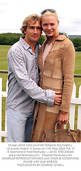 Model JODIE KIDD and MR TARQUIN SOUTHWELL, at a polo match in Surrey on 11th May 2003.PJK 17