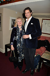 The MARCHIONESS OF READING and her son in law RUPERT FINCH at a party hosted by Lady Kinvara Balfour, Lavinia Brennan and Lady Natasha Rufus Isaacs to celebrate the Beulah French Sole Collaboration in aid of the UN Blue Heart Campaign, held at George, 87-88 Mount Street, London on 10th December 2013.