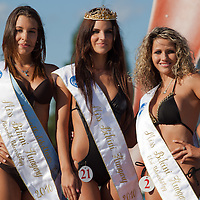 Fanni Krizsa (L) placed third, Livia Peter (R) placed second and Vanda Szamosi (C) winner of the Miss Bikini Hungary beauty contest held in Budapest, Hungary on August 29, 2010. ATTILA VOLGYI