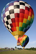 Two balloons take off from Randall Airport in Middletown, N.Y., on July 2, 2005.