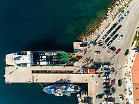 Aerial view of cars disembarking of a ferry, Sumartin, Croatia.