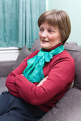 Woman; who has been undergoing Chemotherapy treatment for breast cancer; sitting at home,
