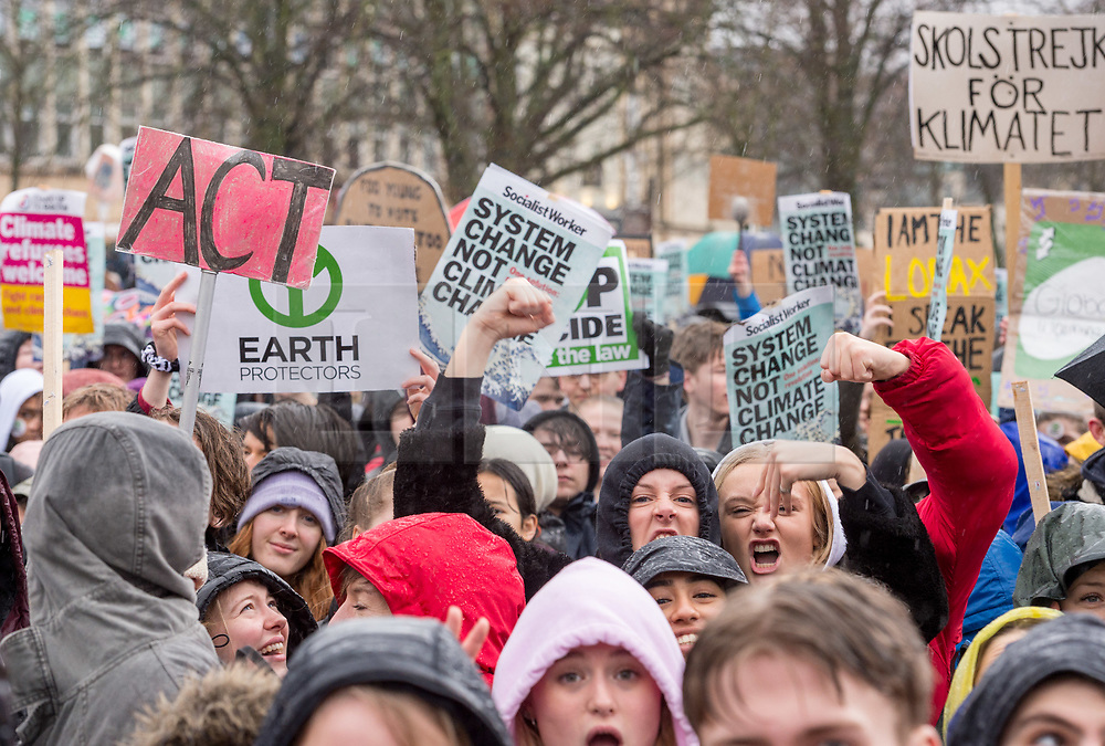 © Licensed to London News Pictures. 28/02/2020. Bristol, UK. Thousands of people gather to hear environmental activist Greta Thunberg speak at the rally march at the Bristol Youth Strike 4 Climate. Greta Thunberg started the Youth Strike 4 Climate protest movement in her home country of Sweden when she sat alone outside the Swedish parliament, eventually paving the way for the Fridays for Future movement across the world. Thousands of people are expected to attend the event in Bristol with many roads closed in the city centre. In 2018 Bristol was the first city to declare a climate emergency and also the first to declare an ecological emergency just four weeks ago. Photo credit: Simon Chapman/LNP.