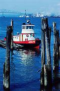 """CS00331-14. tug boat """"Cowlitz"""" at pier in Astoria harbor. Astoria Bridge in background. April 1965"""