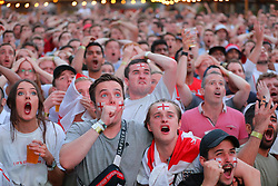 © Licensed to London News Pictures. 11/07/2018. London, UK. England fans in Flat Iron Square, London, react as they watch England play Croatia in extra time in the World Cup semi-final. Photo credit: Rob Pinney/LNP