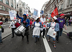 © Licensed to London News Pictures. 18/05/2013. London, UK. Protestors dressed as nurses marching in central London's The Strand against the Government's changes to the Health Service and planned closures to services across London.   Backed by Unite the Union, the Save Lewisham Hospital Campaign and MPs including Andy Slaughter and Steve Pound. Photo credit : Richard Isaac/LNP