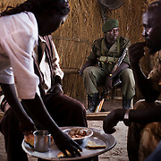 The region of South Kordofan is cut off the rest of the world. No one is allowed to get by the government. In order to bring goods in, a dozen of smugglers got organized in a cross)border market between the region between the SAF and the SPLA-N. Traders, sellers and soldiers who belong to both sides meet there and behave just like the conflict wasn't taking place.