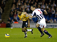 Fotball<br /> Premier League England 2004/2005<br /> Foto: SBI/Digitalsport<br /> NORWAY ONLY<br /> <br /> West Bromwich Albion v Newcastle United<br /> <br /> Newcastle's Charles N'Zogbia (L) escapes a challenge from Riccardo Scimeca