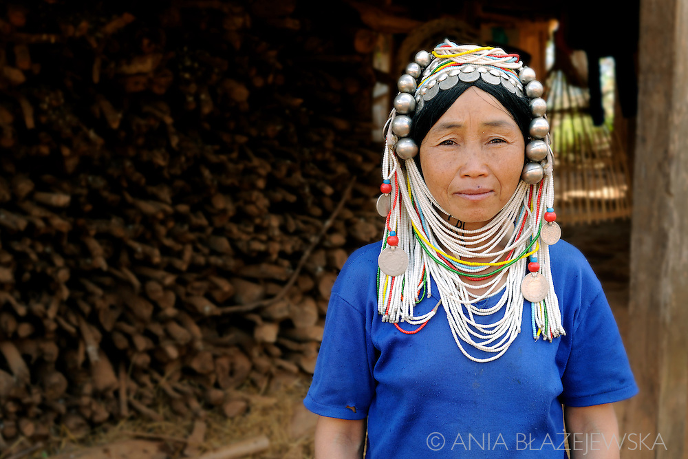 Myanmar/Burma. Portrait of a woman from Akha hilltribe wearing traditional headdress.