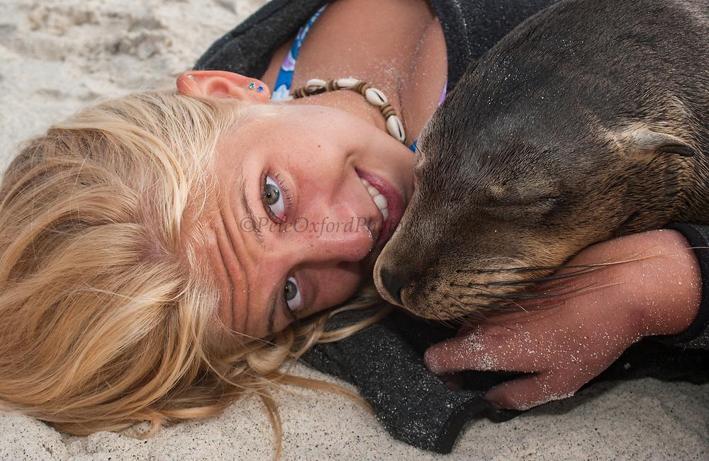 Galapagos Sea Lion & Tourist (Julie Stewart)<br /> Zalophus californianus wollebacki<br /> Gardner Bay, Española (Hood) Island<br /> Galapagos Islands, ECUADOR.  South America