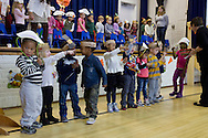 """Middletown, New York - Preschool and pre-K students line up during the """"YMCA Thanksgiving Day Spectacular"""" in the gymnasium at the Center for Youth Programs on Nov. 27, 2013."""
