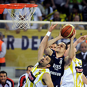 Fenerbahce Ulker's Omer ONAN (L) and Efes Pilsen's Igor RAKOCEVIC (C) during their Turkish Basketball league Play Off Final third leg match Fenerbahce Ulker between Efes Pilsen at the Abdi Ipekci Arena in Istanbul Turkey on Tuesday 25 May 2010. Photo by TURKPIX