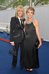 Left to right, JANE MOORE and JO ELVIN at the Glamour Women of The Year Awards in Association with Next held in Berkeley Square Gardens, Berkeley Square, London on 3rd June 2014.