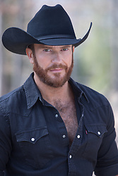 Portrait of a rugged cowboy with a beard