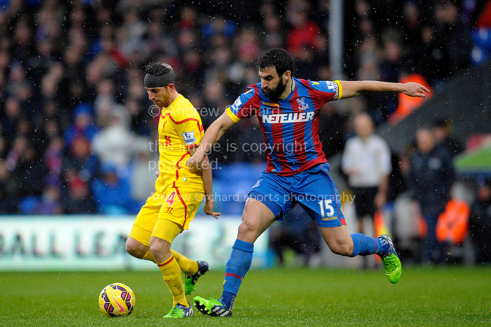Crystal Palace's Joe Allen competes with  Mile Jedinak of Crystal Palace. Barclays Premier league match, Crystal Palace v Liverpool at Selhurst Park in London on Sunday 23rd November 2014.<br /> pic by John Patrick Fletcher, Andrew Orchard sports photography.