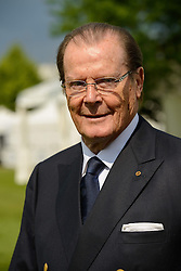 Actor Sir Roger Moore, UNICEF ambassador during day one of the 2013 CHIO Aachen tournament on June 25, 2013 in Aachen, Germany. Photo by Schneider-Press / i-Images. UK & USA ONLY