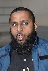 "Westminster Magistrates Court, London, August 5th 2015. Islamist Anjem Choudary is denied bail on terror charges at Westminster Magistrates Court. A colleague Mohammad Shamsuddin, also known as Abu Saalihah issued a press statement saying Choudary and his co-accused Mohammed Rahman will be remanded in custody until August 28th and declared the charges as part of an ongoing persecution of Muslims, declaring that ""one day the black flag of Islam WILL be flying over Westminster"". PICTURED: Close associate of Anjem Choudary Abdul Muhid arrives at Westminster Magistrates Court PICTURED: Mohammad Shamsuddin, also known as Abu Saalihah issues a press statement."