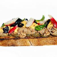 Nederland, Amsterdam , 30 augustus 2014.<br /> Broodje van de week.<br /> <br /> de bruschetta met lamsvlees, peperoncino en aubergine van Merkelbach op de Middenweg 72<br /> Foto:Jean-Pierre Jans