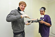 ©INS News Agency Ltd...  19/10/2010.Benedict Cumberbatch (L) Leonie Myrie-Powell (R) Benedict Cumberbatch helps out with the Prince's Trust 'Make a Change Week' by helping decorate classrooms at Cricket Green School in Mitcham London.