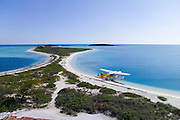 A seaplane is parked on the shore of the Dry Tortugas in the Florida Keys.