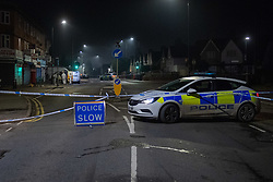 © Licensed to London News Pictures. 11/11/2020. Slough, UK. A police vehicle forms a crodon as forensic investigators gather evidence on Stoke Poges Lane. A person was reportedly stabbed in Slough on Tuesday 10/11/2020. A large cordon was put in place by Thames Valley Police centred around shops on Stoke Poges Lane and included a large section of Bradley Road. Photo credit: Peter Manning/LNP