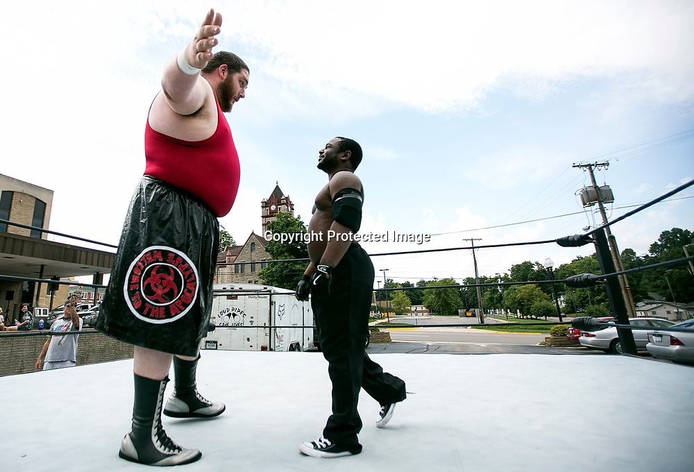 """William """"Chocolate tic tac"""" Blount wrestled Jerry """"Brutus Dylan"""" Wilson in a charity bout in the rear parking lot of the Cassoplis City Hall on Sunday August 28, 2016.  Cocolate tic tac is 4'11"""" and defeated Brutus Dylan 6' 6"""" after being knocked out of the ring. Tribune Photo/SANTIAGO FLORES"""