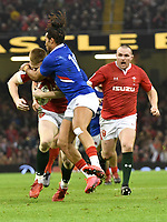 Football - 2020 Guinness Six Nations Championship - Wales vs. France<br /> <br /> Josh Adams,  of Wales tackled by Teddy Thomas, of France, at the Principality (Millennium) Stadium.<br /> <br /> COLORSPORT/WINSTON BYNORTH