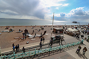 People enjoy the Sunny weekend as they walk and enjoy different activities along the Brighton Beach on Sunday, April 11, 2021- as the city is preparing for stage 2 of roadmap out of lockdown. On Monday, April 12, England enters the next stage of government's roadmap out of lockdown, when the non-essential shops, outdoor hospitality, and personal services including hairdressing can open again. (Photo/ Vudi Xhymshiti)