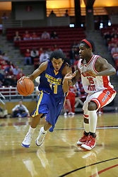 06 December 2008: Terrance Hill drives in hard against Champ Oguchi during a game where the  Illinois State University Redbirds extended their record to 9-0 with a 76-70 win over the Eagles of Morehead State on Doug Collins Court inside Redbird Arena on the campus of Illinois State University in Normal Illinois