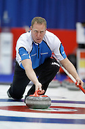 Steve Gould, lead on Jeff Stoughton's team throws his rock in the team's first draw Wednesday.  The 2011 GP Car and Home Players' Championship ran April 12-17 at the Crystal Centre, Grande Prairie, AB..11-04-13, Photo Randy Vanderveen, Grande Prairie, Alberta.