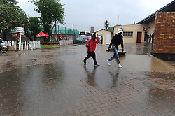 Johannesburg 14-10-18 South Africa v Zimbabwe T20I at Willowmore Park, Benoni. Two men walk around a puddle at the stadium.<br /> Picture: Karen Sandison/African News Agency(ANA)