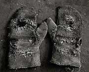 Worn gloves on ground