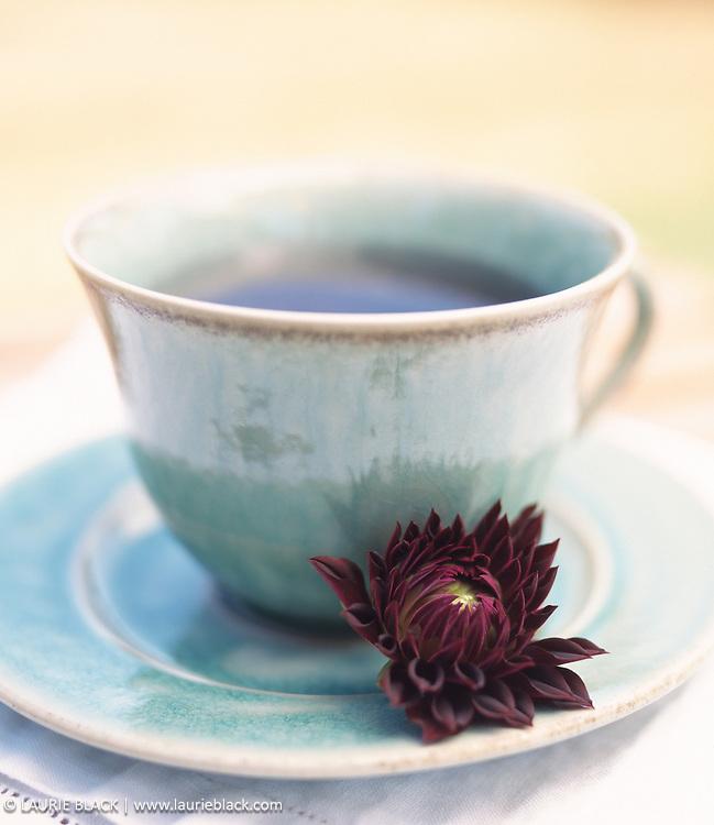 Calming cup of herbal tea and dahlia.