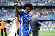 Willian of Chelsea gives a thumbs up to the fans during a walk around the pitch after full time. Barclays Premier league match, Chelsea v Leicester city at Stamford Bridge in London on Sunday 15th May 2016.<br /> pic by John Patrick Fletcher, Andrew Orchard sports photography.