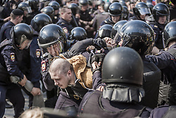 May 5, 2018 - Moscow, Moscow, Russia - A man is arrested by riot police in a demonstration against Putin in Pushkin square, Moscow. (Credit Image: © Celestino Arce via ZUMA Wire)
