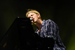 © Licensed to London News Pictures. 17/07/2013. London, UK.   Tom Odell performing live at Somerset House. Tom Odell is a British singer-songwriter. He released his debut extended play, Songs from Another Love, in 2012 and won the BRITs Critics' Choice Award in early 2013.   His debut studio album, Long Way Down, was issued on 24 June 2013.   Photo credit : Richard Isaac/LNP