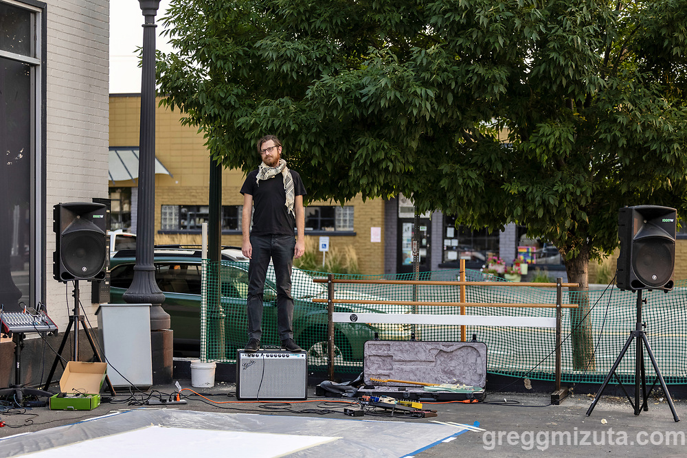 Ryan Garrett. Multimedia Iraqi-American artist Luma Jasim collaborates with musician Ryan Garrett to produce a performance that combines improvised live large-scale painting and music at LED's Art on the Block series in Boise, Idaho on September 2, 2021.